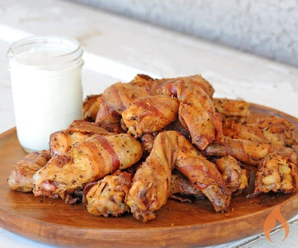 Bacon Wrapped Chicken Wings on wooden platter