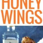 holding wing with tongs with glaze dripping off near bottle of Jack Daniels Honey