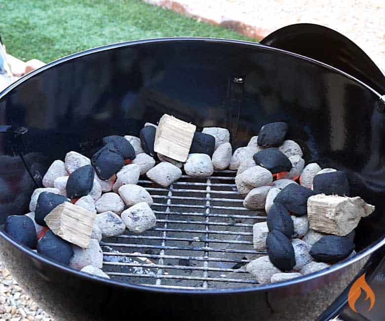 charcoal in circular shape with wood chunks added