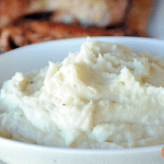 cream bowl full of Grilled Mashed Potatoes from Girls Can Grill