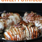 sweet potato in skillet sliced and oozing with marshmallow