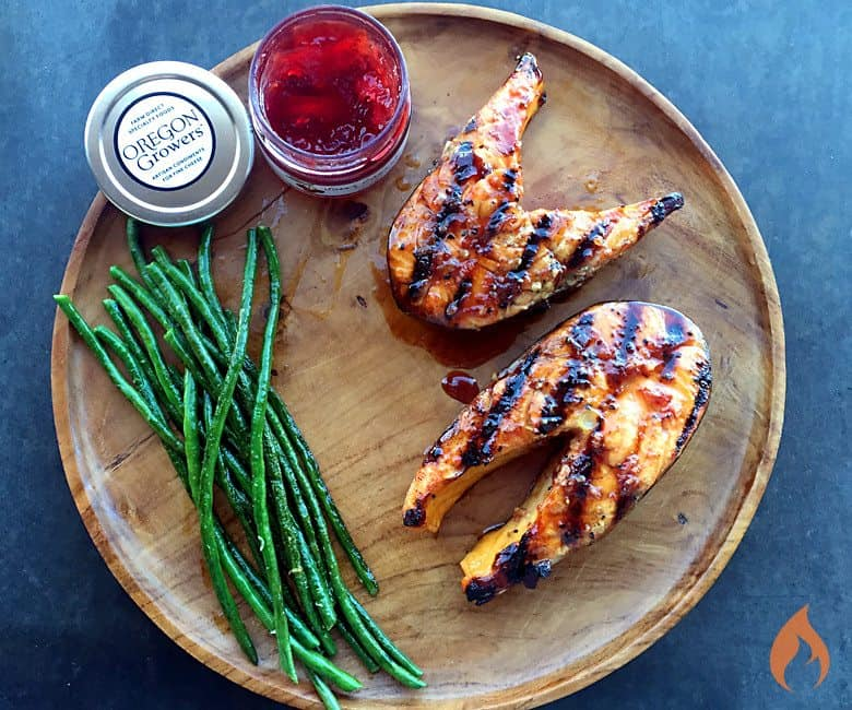 2 grilled salmon filet with char marks and green beans