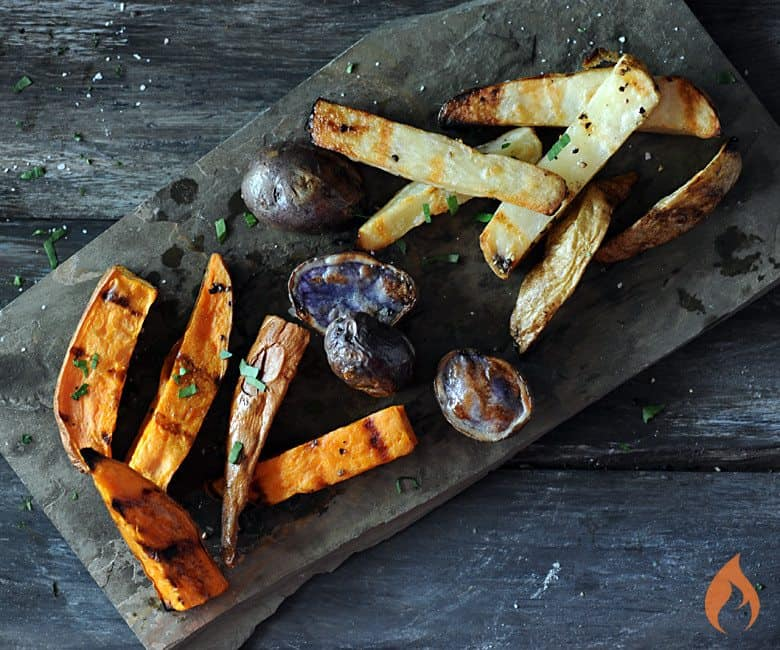 grilled varietal potatoes on slate background