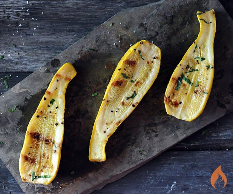 grilled yellow squash on slate background