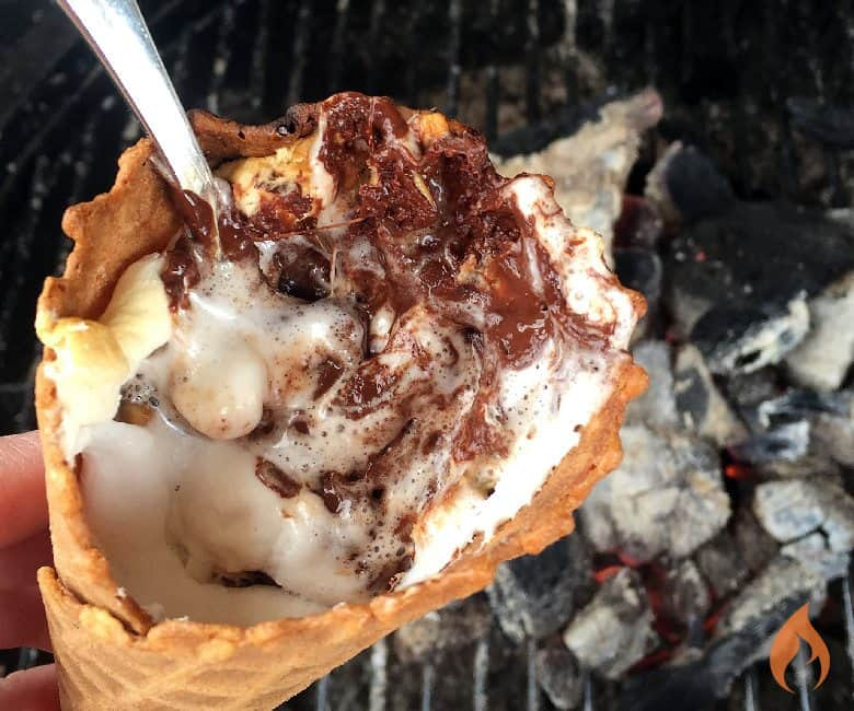 waffle cone near grill filled with melted chocolate and marshmallows