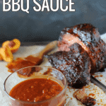 pork with bowl of peach bbq sauce to side