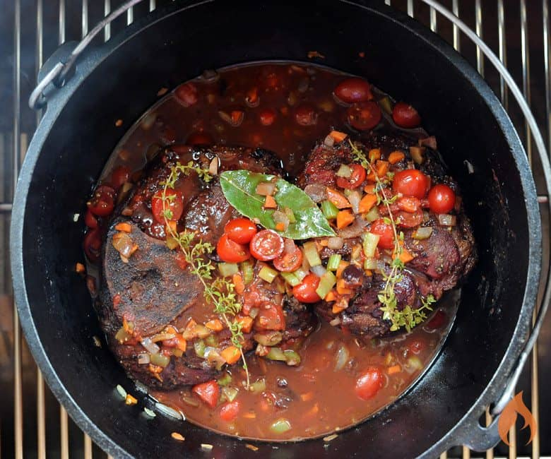 post on grill filled with osso buco stew