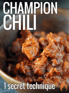 wooden bowl full of meaty chili