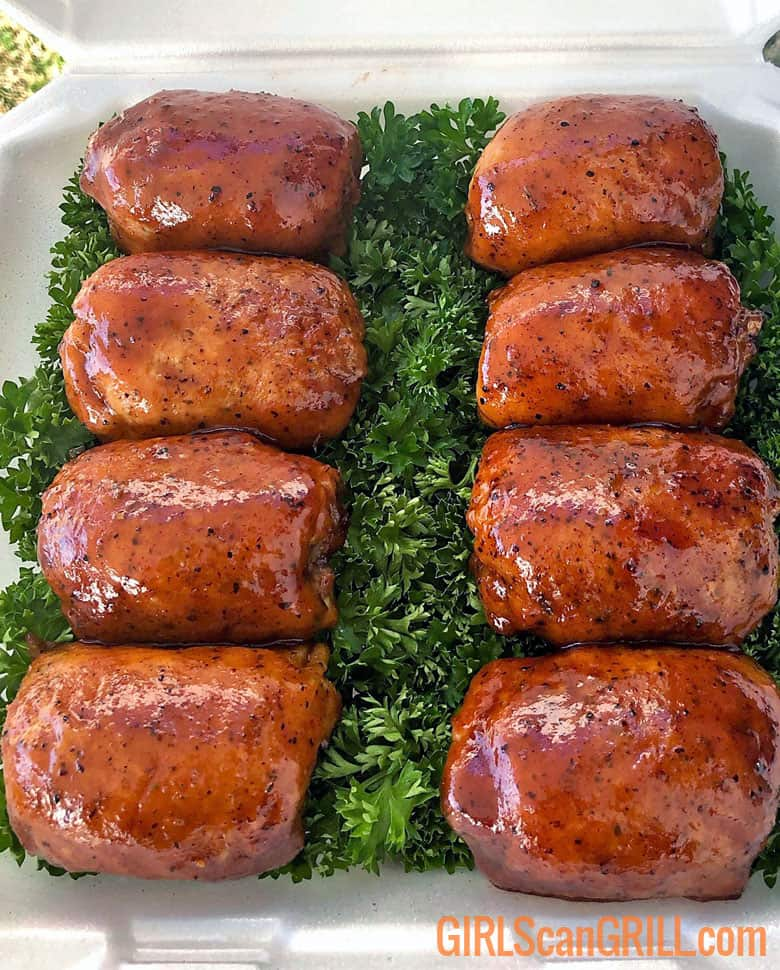 8 bbq chicken thighs on a bed of parsley
