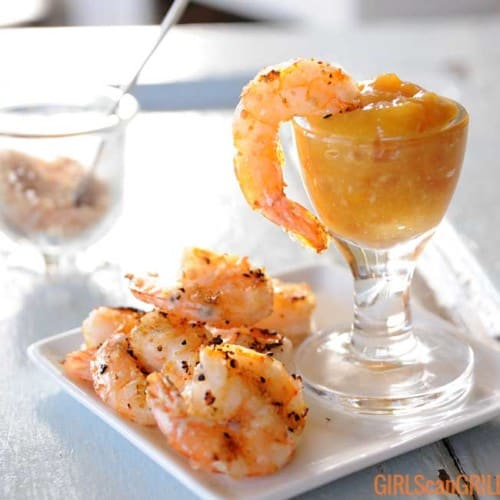 grilled shrimp on plate with one dipped in sauce