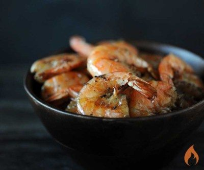 black bowl with 7 grilled shrimp inside