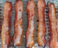 slices of bacon cooked on a baking sheet