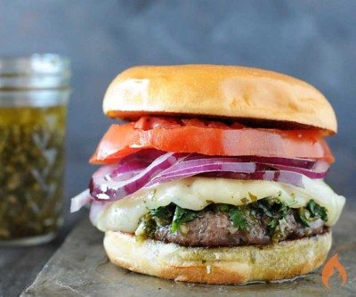 burger with tomato, red onion, white cheese and chimichurri sauce