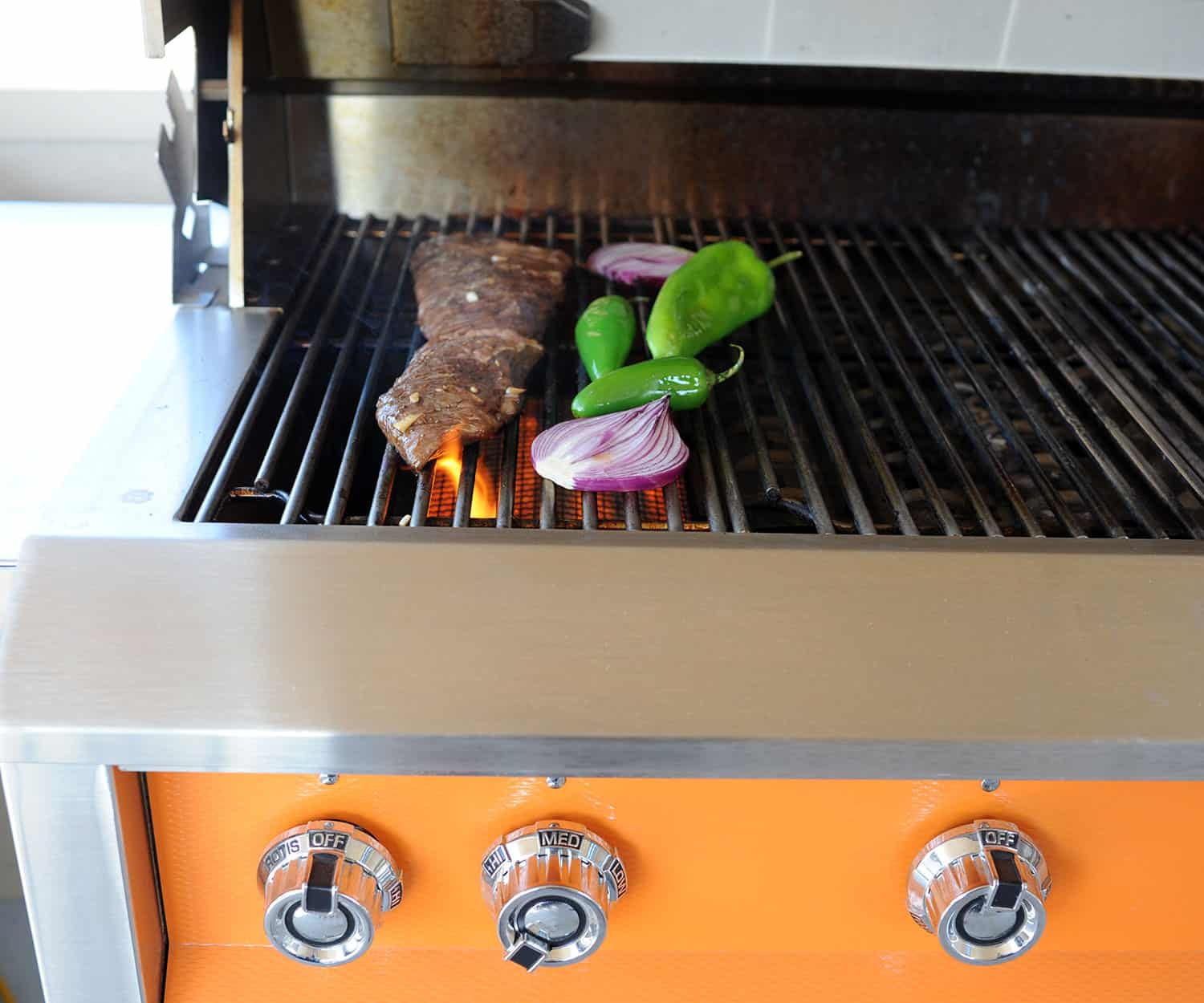 flame kissing steak on grill