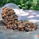 container of granola spilling onto table