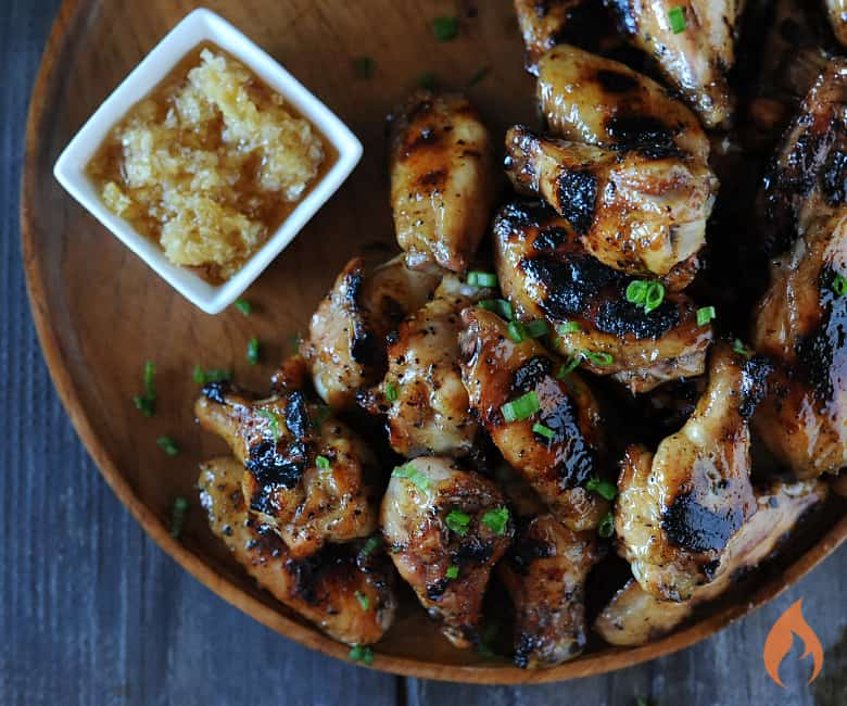 wooden platter with sticky wings