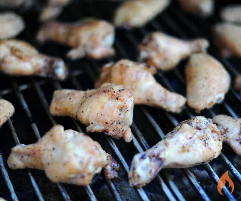 chicken wings cooking on a grill