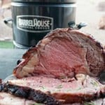 Prime Rib Roast Sliced with grill in background