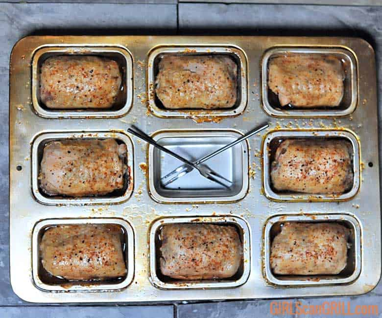 chicken thighs in mini loaf pan with seafood forks in middle cavity