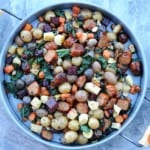 Overhead photo of roasted root vegetables on a round platter