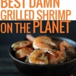 grilled shrimp in dark wood bowl