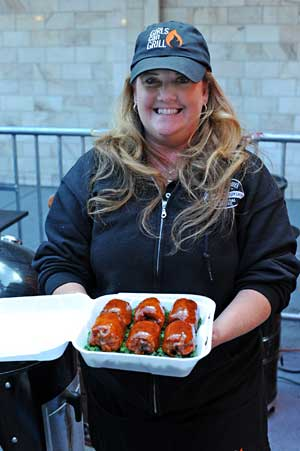 Female Pitmaster Christie Vanover holds a turn-in box filled with chicken