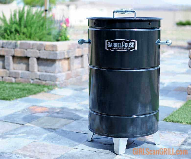 barrel house cooker on slate patio near planter box