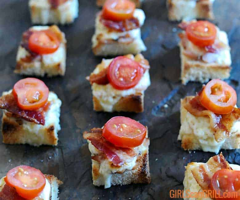 3 vertical rows of hot brown sliders topped with tomatoes