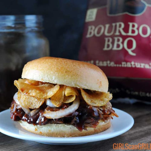 pulled pork sandwich with chips on top
