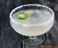 glass of smoked jalapeno margarita with lime and jalapeno