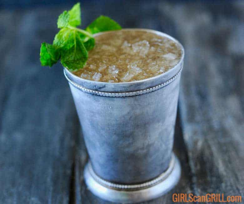 smoked mint julep on gray background with mint sprig