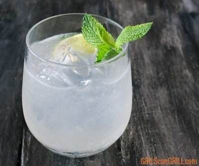 smoked mojito in glass on gray background with mint sprig