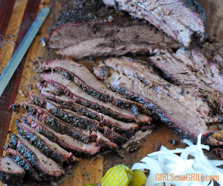 brisket sliced with a side of pickles and onions