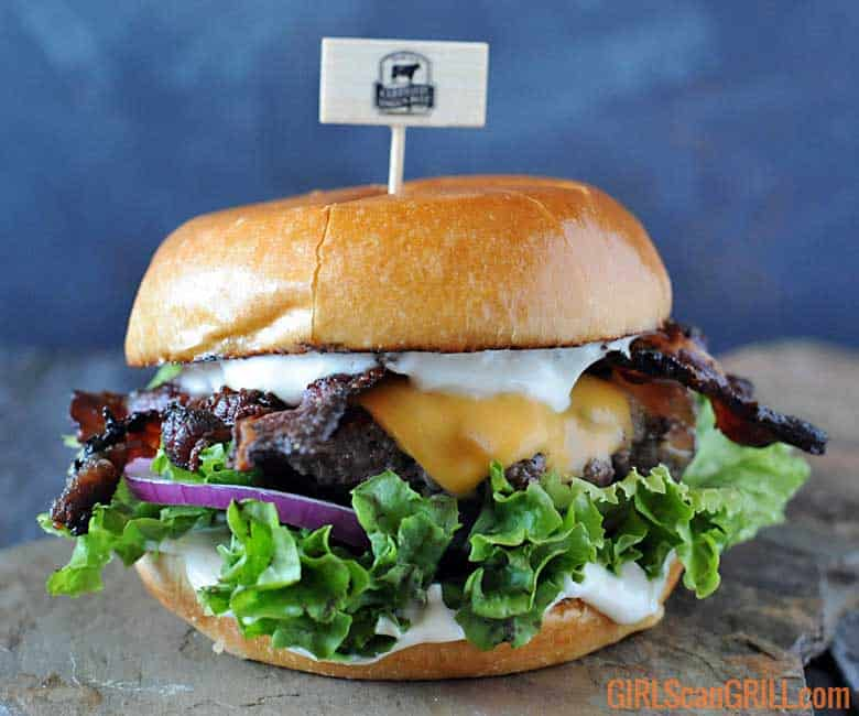 hamburger on slate with lettuce, cheese and mayo