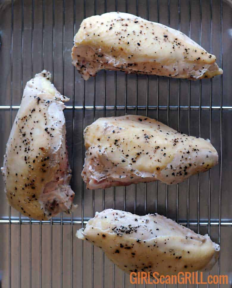 4 sous vide chicken breasts on sheet pan with rack