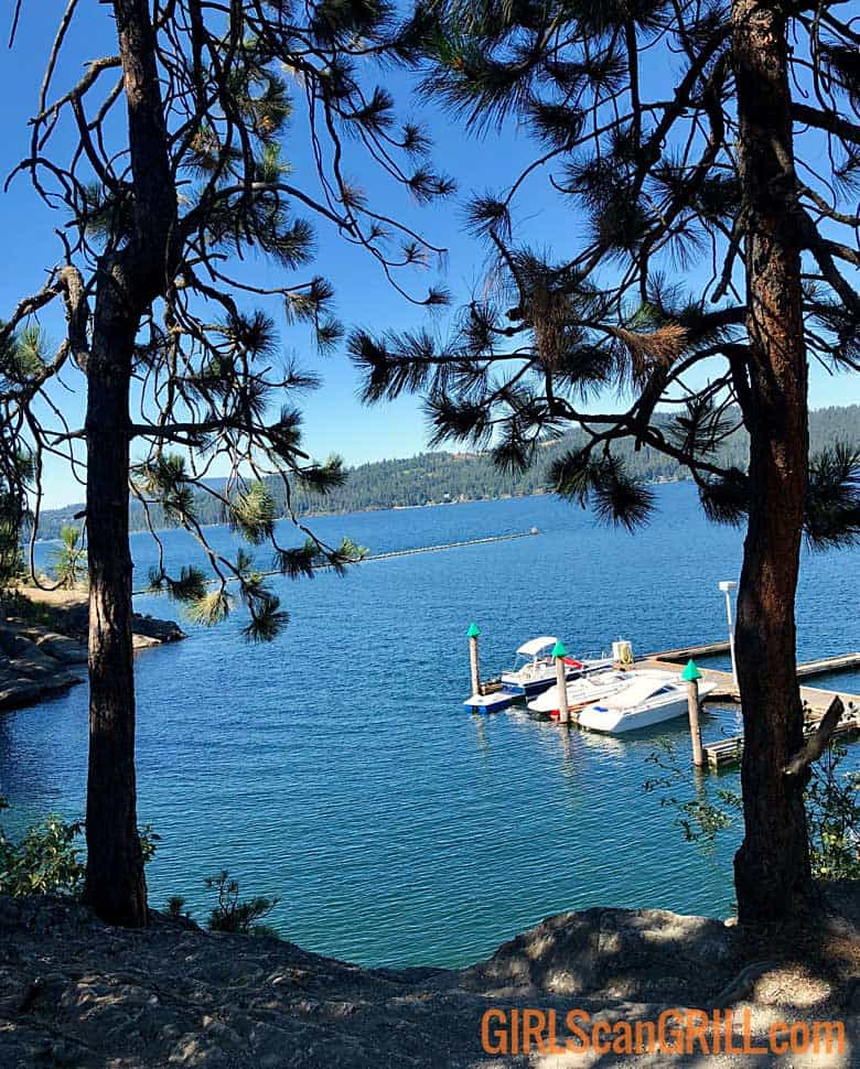 Visit Idaho - view of Lake Couer d'Alene with docks and boats