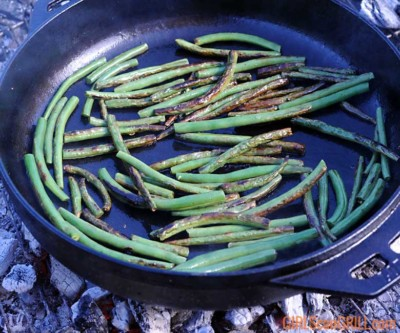 garlic green beans sauteeing in cast iron skillet