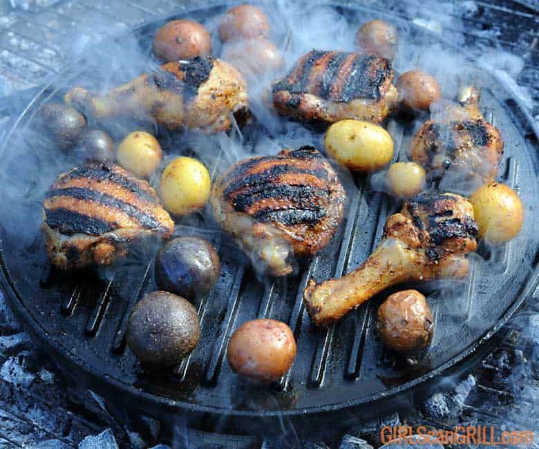 chicken on grill with grill marks and potatoes