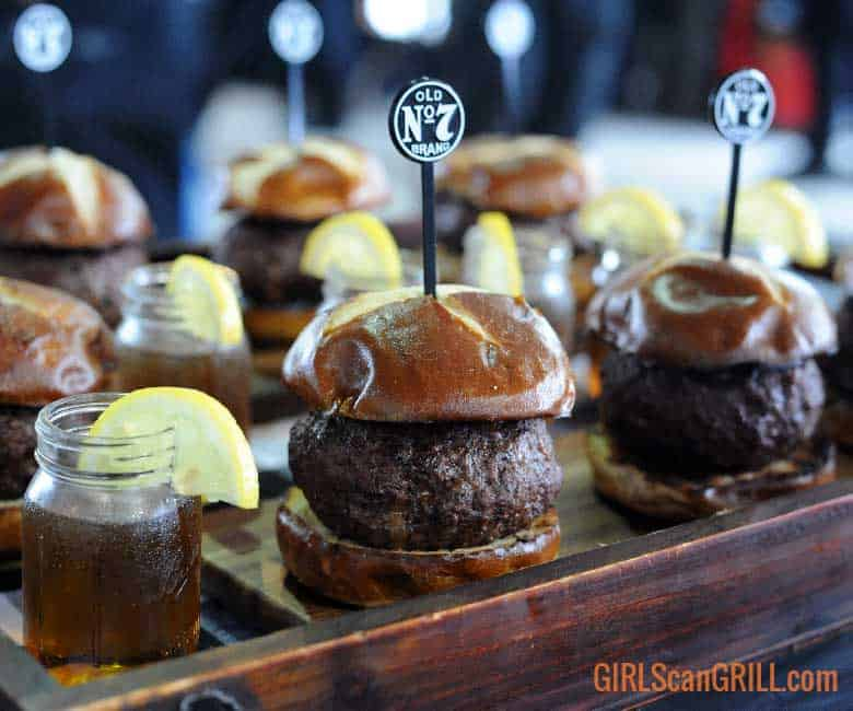sliders on a wooden platter with shots