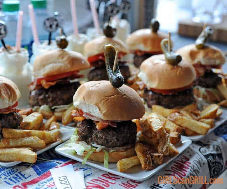 plates full of sliders and fries