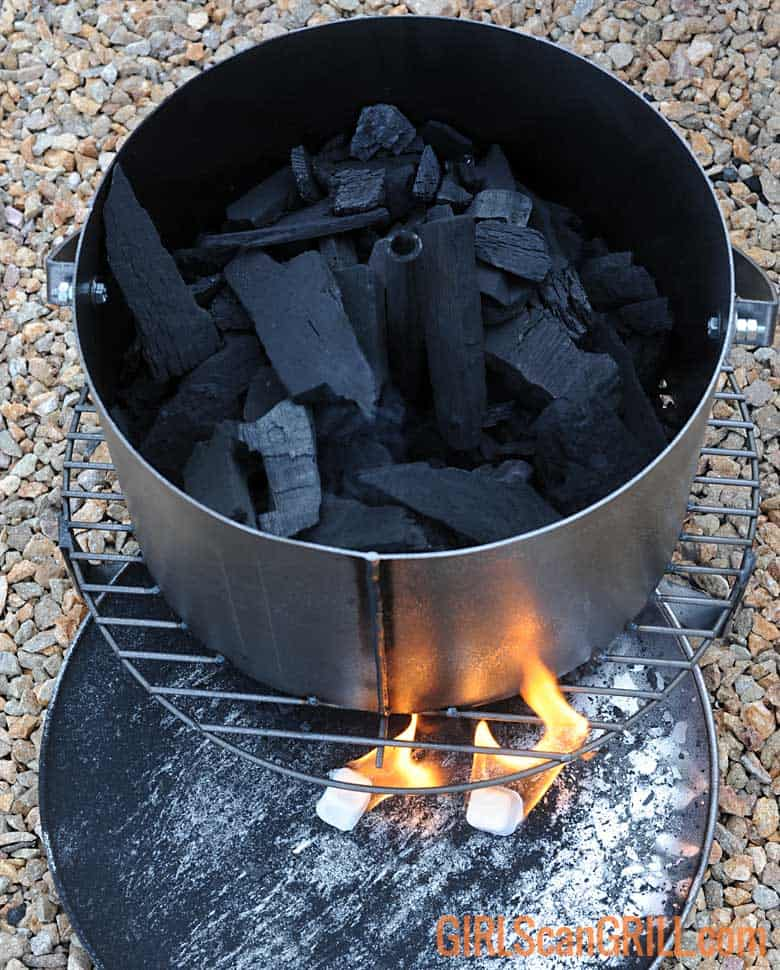 charcoal in metal basket with fire cubes burning below