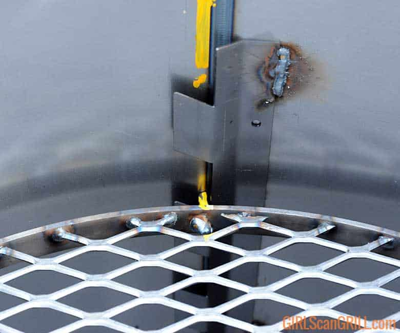 cooking grate hanging on welded rack holder in smoker