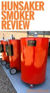 three orange Hunsaker drum smokers