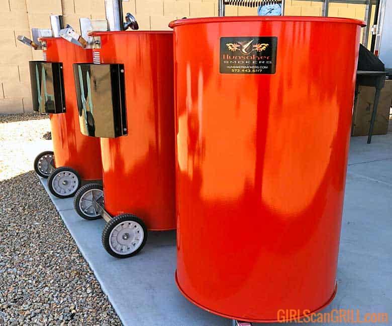 three orange Hunsaker drum smokers