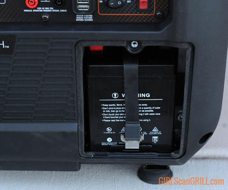 battery fastened inside compartment of generator