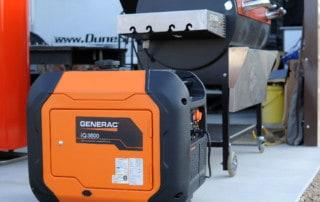 orange generator near pellet grill