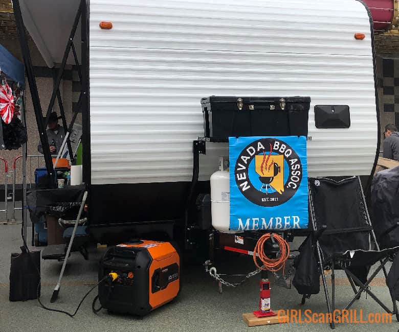 trailer with Nevada BBQ banner and generator on ground to left
