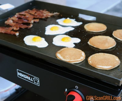 bacon, eggs and pancakes on a griddle top