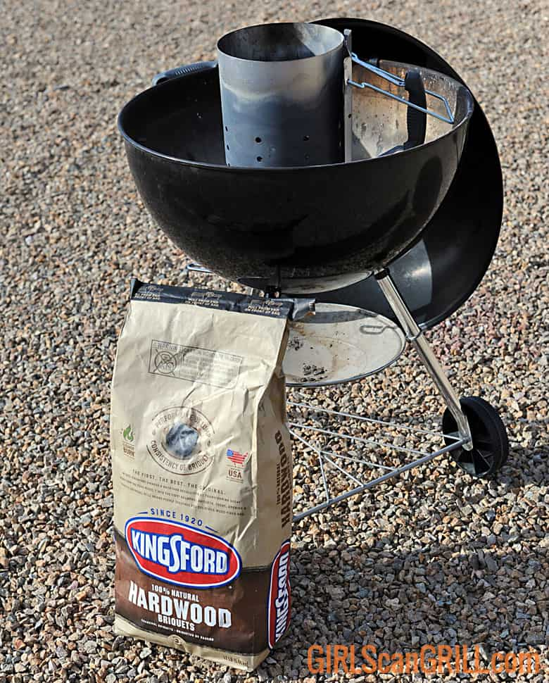 bag of Kingsford Hardwood next to a kettle grill
