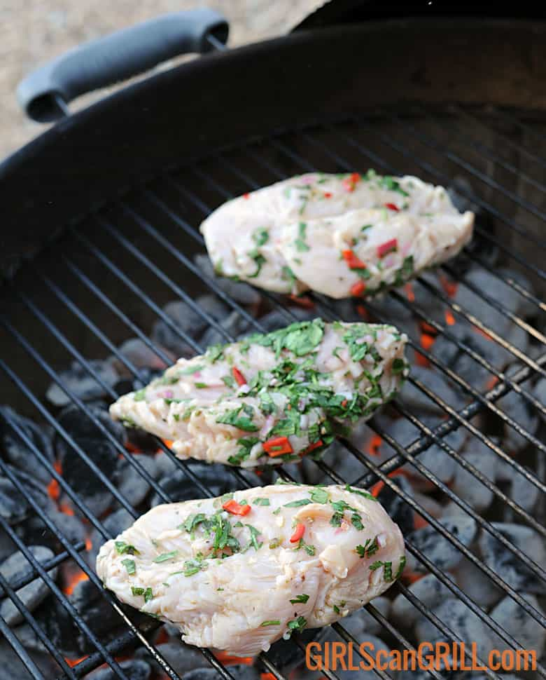 3 raw chicken breasts on grill